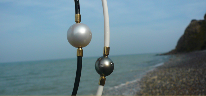 Australia white and Tahiti black pearls as interchangeable clasps on rubber necklaces